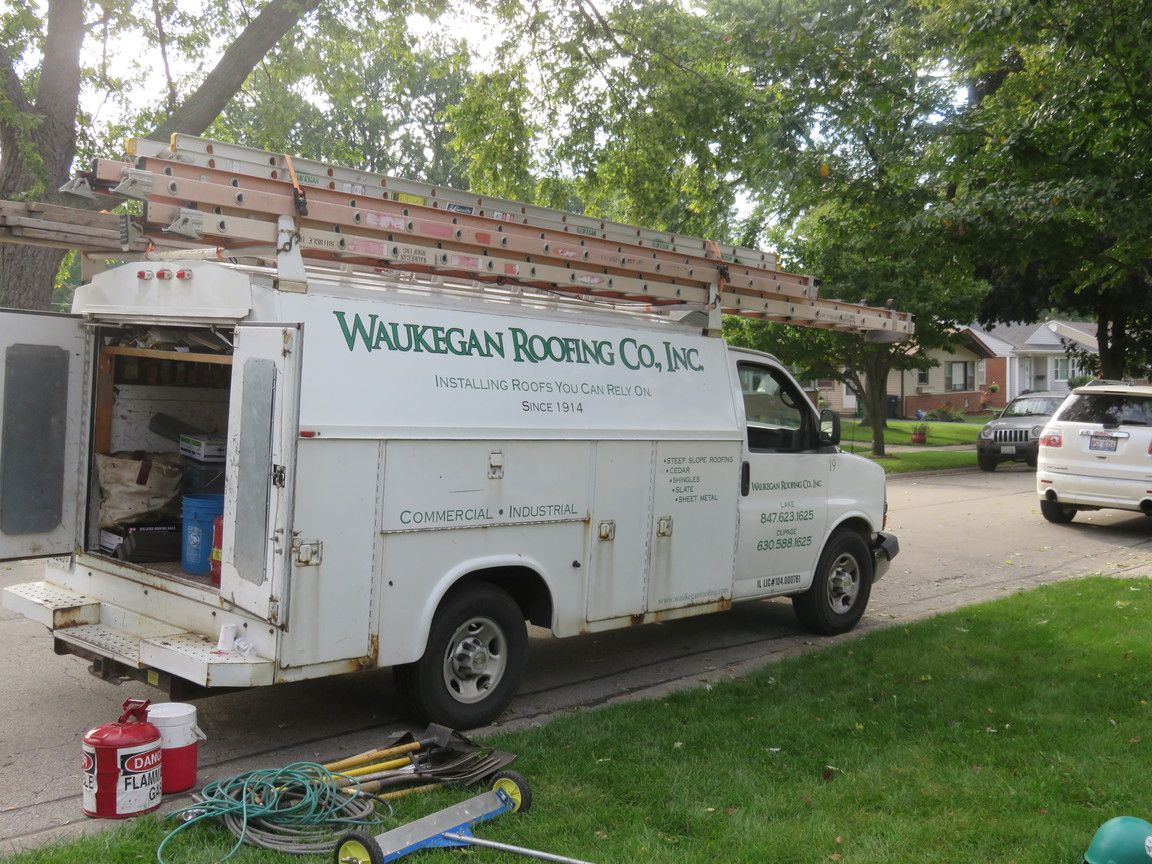 Waukegan Roofing employees donated their time to install the new roof for the WRC Gives Back recipients.